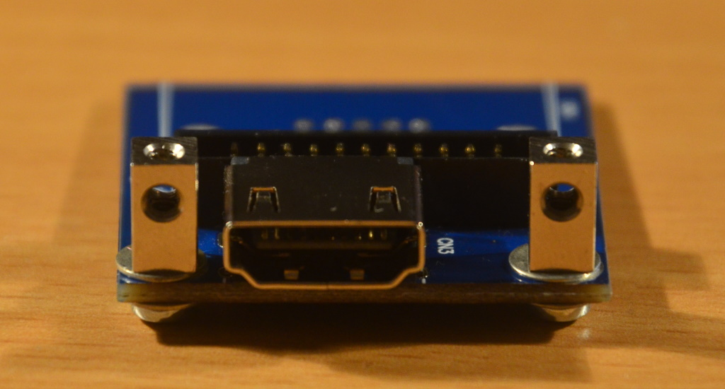 The video board with the VGA connector removed and two stand-offs next to the HDMI connector